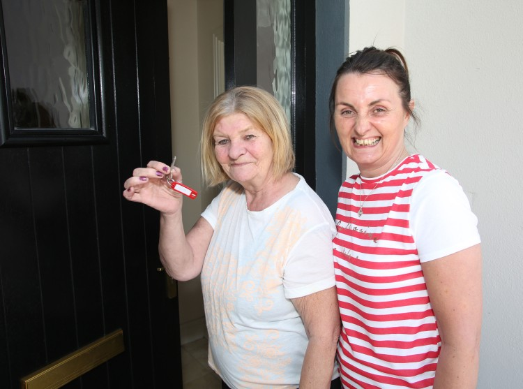 Mary Fitzgerald about to enter her new home in  Wallers Well accompanied by her daughter Tanya.    Photograph Liam Burke/Press 22