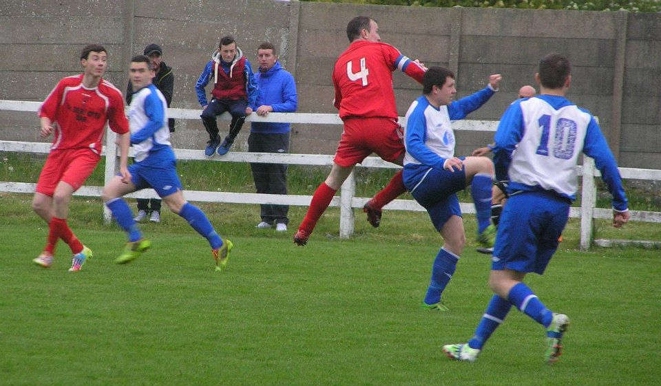 Players anticipate the delivery of the ball in Newmarket Celtic vs Burren Utd. Picture Credit: Oliver Fitzpatrick