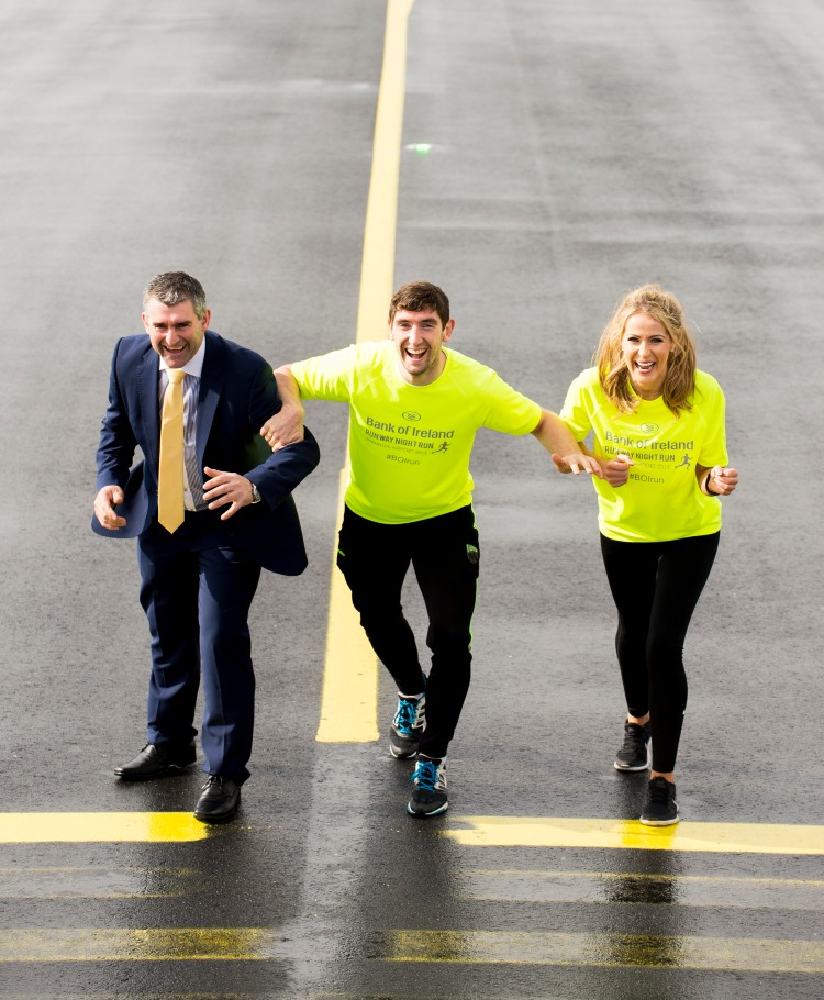 At the launch of the Shannon Airport Runway Run, sponsored by Bank of Ireland, are, from left to right, former Tipperary hurling manager and BOI area manager Liam Sheedy, Kerry footballer and BOI Youth Co-ordinator Killian Young, and participant and model Mary Lee, from Gort, Co. Galway. Shannon Airport, Co. Clare. Picture credit: Diarmuid Greene/Fusionshooters